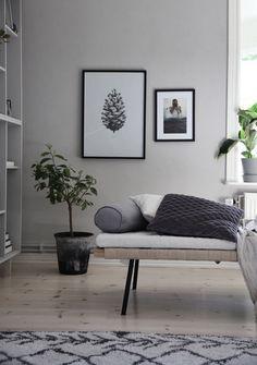 Scandinavian living room with black & white photos & IKEA bookshelf hack