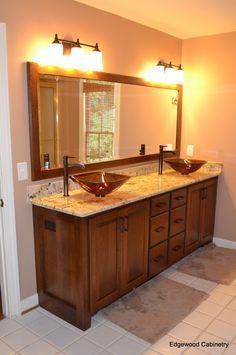 Cherry bathroom vanity with matching mirror frame.