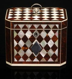 A rare and beautiful Georgian 'harlequin' tea caddy, tortoiseshell and mother-o-pearl diamond panels edged with ivory and set between tortoiseshell canted corners, the metal fittings of silver. English circa 1790.