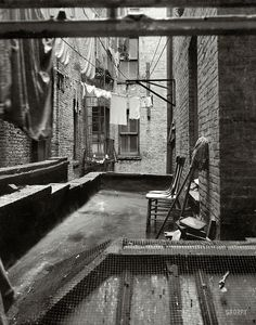 """by Dorothea Lange June """"View out of rear window tenement dwelling of Mr. Jacob Solomon, 133 Avenue D, New York City. The Solomon family are all on the accepted list for resettlement at Hightstown, New Jersey. Annie Leibovitz, Messina, Old Photos, Vintage Photos, Dorothea Lange Photography, Shorpy Historical Photos, Vintage New York, Lower East Side, Slums"""