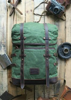 "Our ""Blake"" Adventure backpack/rucksack is perfect for backpacking around Europe or a hike around the forest. Constructed out of super durable waxed duck canvas, thick full grain leather, custom coppe"