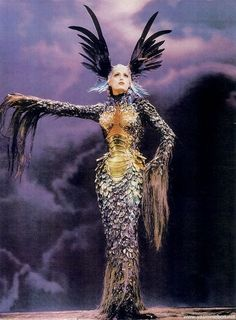 "fantasy costume inspiration. the wing headdress is high drama, and I love the dragon-y ""armor"" of the dress!!"