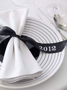 Great idea. Print the year on a ribbon to tie napkins.  Looks like a black and white theme.