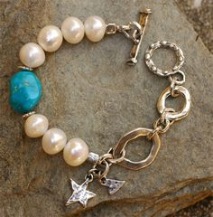 "Winter Skies...  Big luscious Freshwater Pearls like mounds of snow against a gorgeous rare collectible Turquoise nugget. The turquoise is old stock from the ""Old Fox Mine"". A stunning speciman!  Bracelet is 7.5 inches fits a wrist size 6.5 perfect"