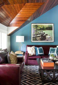 Turquoise walls, graphic rug, burgundy/merlot sofa,    Liz Caan