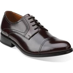 A smart-looking option for any stylish outfit, this men's lace-up shoe is crafted of rich leather with a fabric and synthetic lining. The footbed is cushioned for greater shock absorption and support. Features a classic leather outsole.