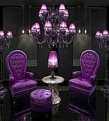 Black walls and bright purple furniture. This would be a awesome reading place. I love the color purple. So this would be perfect for me.