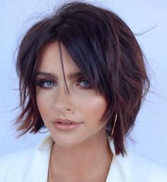 Chic Brunette Bob Shag Short hair for a round face is easily styled with a chic shaggy bob. This cut with short layers, a middle part, and piece-y locks stuns with its rich dark color and… Short Hair Cuts For Round Faces, Round Face Haircuts, Short Hair Styles Easy, Hairstyles For Round Faces, Medium Hair Styles, Short Haircuts, Popular Haircuts, Short Shaggy Hairstyles, Round Face Short Hair