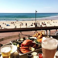 Now this looks like a rather nice way to spend the afternoon - fresh seafood paired with incredible views from the Noosa Surf Club deck over Noosa Main Beach!