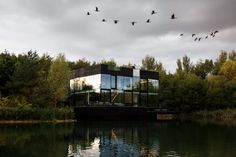 Window walls surround all sides of Glass Villa in the Lake, a three-storey house built by Dutch studio Mecanoo in the Cotswolds. Mecanoo designed the house t. Luz Natural, Lake Villa, Piscina Interior, Modern Lake House, Lake Pictures, Photo Grid, Floating In Water, Seen, Floor To Ceiling Windows