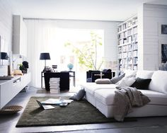 Thee Ikea lounges instead of using a sofa.  Love this idea in a family room!