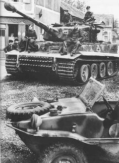 Tiger tank with crew resting on hull, sat in a town. #worldwar2 #tanks