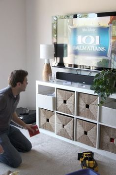 the first time i've seen one of these bookcases look GOOD as a tv stand. awesome! love it.: