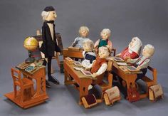 An exceptionally rare example of the School Set with Professor and 6 pupil stuffed felt dolls and wooden desks and lectern, formerly of the Prader Museum, auctioned in 2012 for US $50,000, Germany, 1910-20, by Steiff.