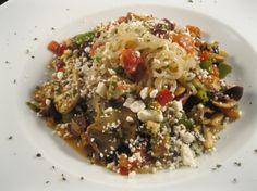 Mediterranean Pasta with spaghetti, pasta, olive oil, onions, garlic, kalamata, green bell pepper, mushrooms, tomatoes, oregano, salt, pepper, feta cheese