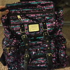 Juicy couture backpack Sparkly blue purple black. Super cute and goes with anything. Brand new Juicy Couture Bags Backpacks