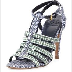 NEW TORY BURCH Printed fabric calico sandals 6.5 SOLD OUT EVERYWHERE AND HARD TO FIND! The strappy silhouette of this sandal is taken to chic new heights. This gladiator-inspired style has a slightly stacked stiletto heel that's leg-lengthening and adds stability. It's the perfect pair to step up day or evening looks with an exotic and textural note. Guaranteed authentic. Made in Brazil. New with tags, no box or bag. Tory Burch Shoes Sandals