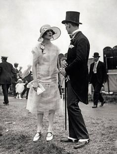 Photographed at Ascot in 1925, this lady wears a chiffon drop-waisted dress with a silk sash and Mary-Janes.