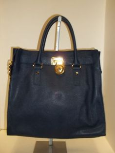 This MICHAEL KORS Navy Blue Saffiano Leather  N/S Hamilton Tote is simply classic and would make the perfect Fall Accessory!