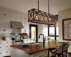 Kitchen With Linear Chandelier Overt Island