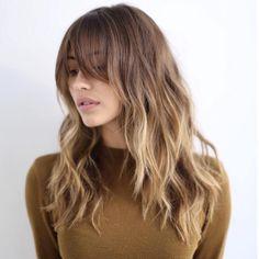 Layered Hair with Long Wispy Bangs