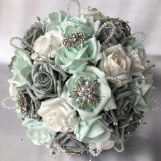 Artificial Wedding Flowers, Brides Posy Bouquet with Mint Green, Grey and White Roses with brooches, crystals and diamantes Mint Green Wedding Dress, Mint Wedding Themes, Teal And Grey Wedding, Grey Wedding Decor, Wedding Colors, Mint Wedding Flowers, Wedding Ideas, Wedding Decorations, Mint Green Flowers