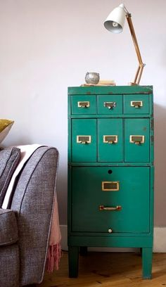 turquoise cabinet, white longnecked lamp, grey chair...plus some nifty storage