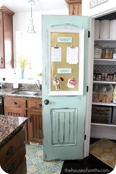 Yet another refurbished door turned pantry door idea.  We especially love the color and use of space for organization on this one.  interior design. kitchen remodel. repurposed door. vintage doors.