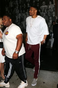 Russell Westbrook wearing  Unravel Distressed T-Shirt, Vans Checker Slip On