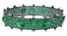 Gemfields bangle by Nam Cho is made with 23ct of Zambian emeralds in varying sizes of cabochon cuts for a dramatic and very tactile effect.via the jewellery editor