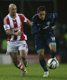 Chicharito in action with Stephen Ireland of Stoke City