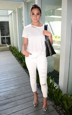 Pretty in white: Gal Gadot, 32, wore a loose white T-shirt and matching jeans at the Philanthropy Give Back Garden Party in Los Angeles on Wednesday