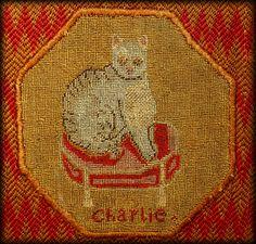 """Charlie"" a Cat needlework.  c. 1840."