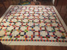 Bonnie Hunter's garlic knot. Scrappy quilt of 2 1/2 inch squares.