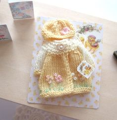 Knitting Patterns Coat dollhouse knitted coat and hat hand embroidered scale miniature by Rainbowminiatures on Etsy Knitted Coat, Knitted Dolls, Knitted Baby, Heidi Ott, Selling Handmade Items, Christmas Knitting, Doll Clothes Patterns, Tiny Dolls, Beautiful Dolls