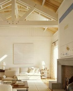 The beamed ceiling and white and ivory palette are perfection in this setting.