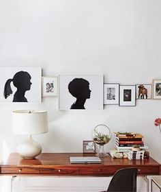Make a Tight-Knit Row of Sentimental Family Pictures | Been meaning to deal with your bare walls forever, but stuck on the what, where, and how? Try these unexpected, picture-perfect plans to brighten all your blank spots.