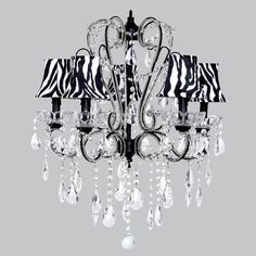 Black carousel chandelier with zebra print Dupioni Silk bell sconces.  Oozing with dripping crystal teardrop prisms. Adds a little exotic whimsy..