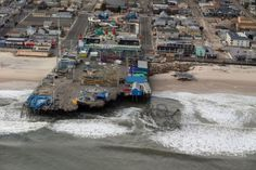 The Casino Pier in Seaside Heights, New Jersey, after Hurricane Sandy. The Casino Pier coaster will be removed from the water.