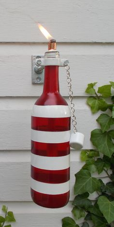 red white and blue wine bottle tiki torches
