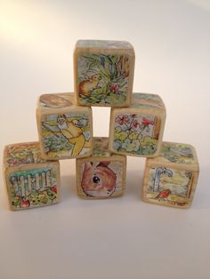 The Tale of Peter Rabbit // Childrens Book Blocks // Natural Wood Toy // Baby Shower. $22.00, via Etsy.