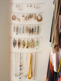 So simple, yet so clever: Earrings and necklaces hang from bands of wire strung along a closet wall. Avoid tangles by leaving plenty of space in between each.
