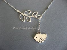 Silver Lariat Necklace Bird necklace, Branch Necklace, Bird and Branch Necklace, Silver Bird Necklace  This pretty necklace features a silver plated twig with open leaves and a cute little sparrow. This is a lariat style necklace, which gives you options for length and style. Adjust length by pulling the bird. This is a great necklace for everyday wear as well as special occasions!  Branch measures 40mm by 20mm. Bird measures 17mm by 12mm. Silver plated chain is 18.  Earrings sold…