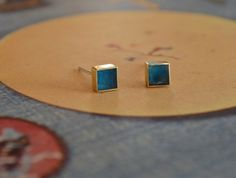 Small blue brass studs with sterling silver backs