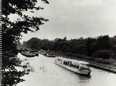 BW192-3-2-2-13-1-591Pleasure boat 'Water Rambler' on the Warwick Section of the Grand Union Canal Description Black and white photograph taken from beside the canal, shows Syd Mitchell steering the boat having just exited a wide lock which can be seen behind the boat. Date June 1961