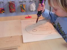 Wood burning art. Definitely a closely supervised activity. But, so cool!