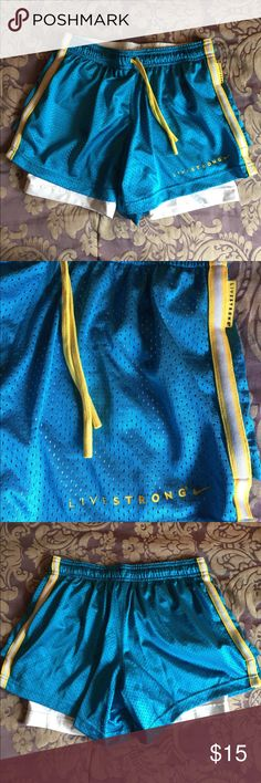 NIKE Livestrong Shorts Dri-Fit NIKE Livestrong blue and yellow Sport Shorts. Only used once. Women's small. Dri-fit. Build in compression shorts make these great for exercising and sports. Nike Shorts
