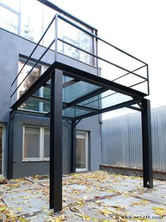 This private backyard is rejuvenated by the presence of this freestanding structure that creates a canopy for the ground floor and balcony for the second. The structure stands almost daintily on the adjustable feet integrated into the legs. Blackened steel I-beams and structural steel harmonize with the clean lined architecture. Tempered glass provides unobstructed views through the landing.