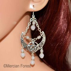 Welcome to our listing for the Ornate Crescent Moon Pentacle Earrings.  Hand crafted using quality components the earrings feature an ornate Tibetan Silver Crescent Moon centrepiece, with a Pentacle, and is completed with a selection of White Jade gemstone beads, adorned with Tibetan Silver bead caps hanging from a Sterling Silver Hook.  We pride ourselves on the quality of our jewellery and its components; all our Silver Plated chains and Sterling Silver Hooks are sourced from reputable UK… Pagan Jewelry, Unique Jewelry, White Jade, Pentacle, Bead Caps, Gemstone Beads, Wiccan Witch, Drop Earrings, Gemstones