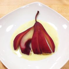 Wine Poached Pears w/a Classic Creme Anglaise (vanilla bean sauce) via Viking Cooking School in SLC